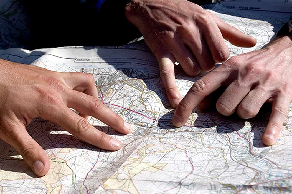 Hands on a map whilst learning to map read.