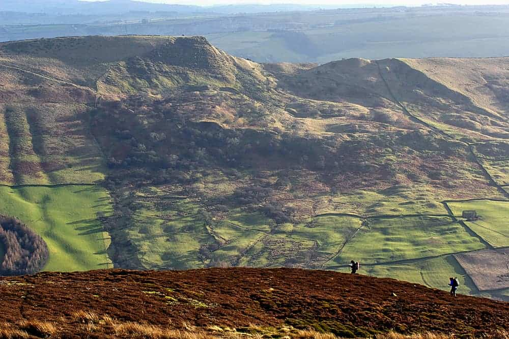 Two people hillwalking in the Peak District
