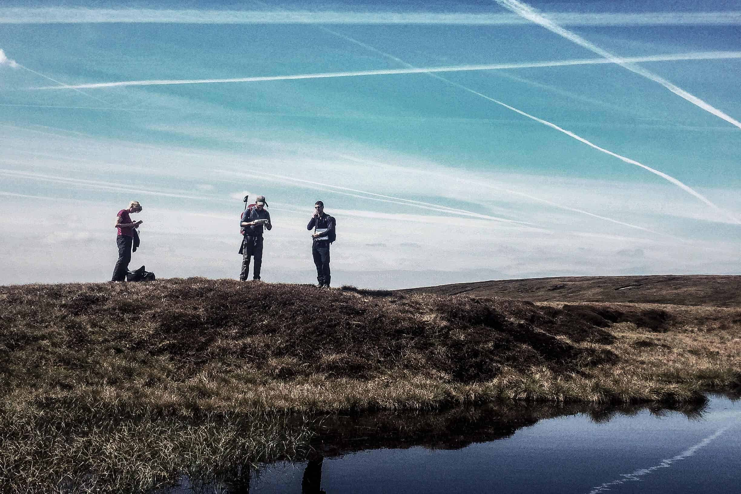 A group practices navigation on a Lowland Leader Course in the Peak District