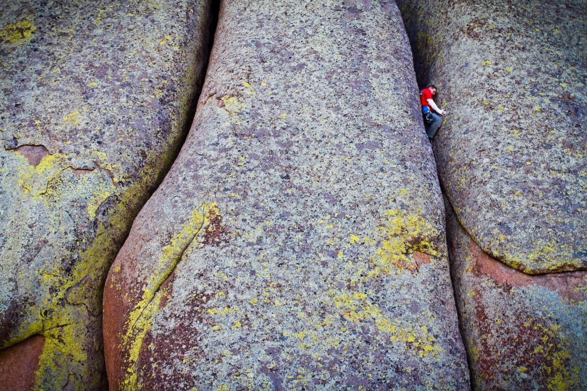 Pete Whittaker off width rock climbing at Vedauwoo, Wyoming in the USA. Photo by Alex Ekins