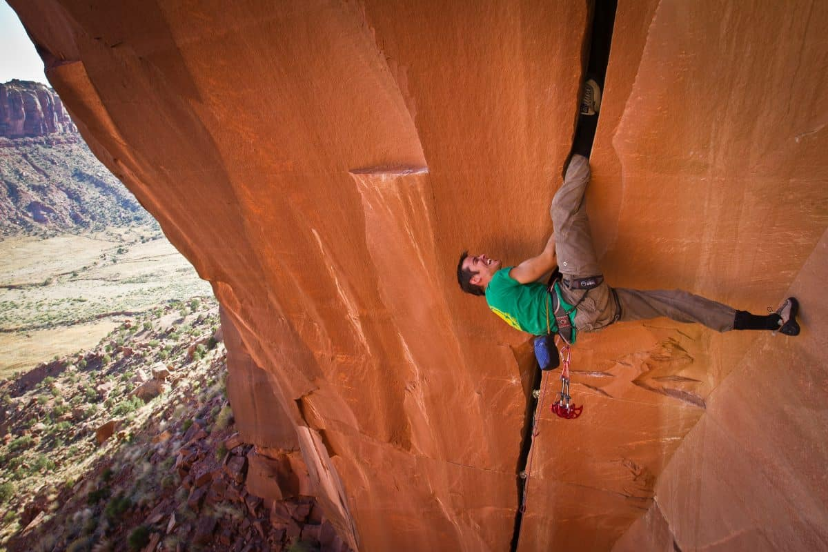 Tom Randall rock climbing on Belly Full of Bad Berries at Indian Creek in the USA. Photo by Alex Ekins