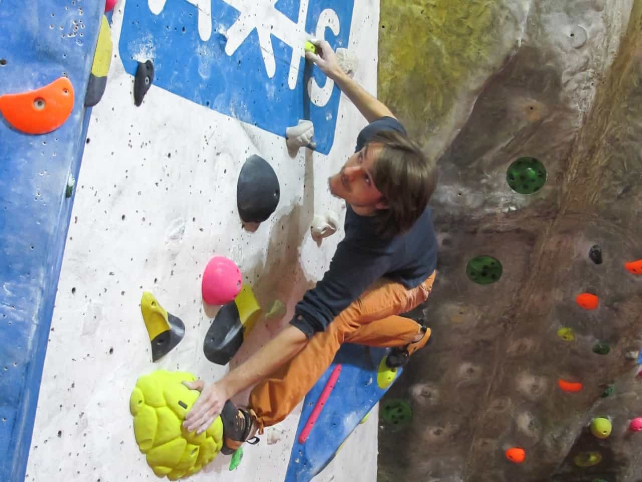 Climbing on a indoor climbing wall whilst on a Climbing Wall Instructor assessment