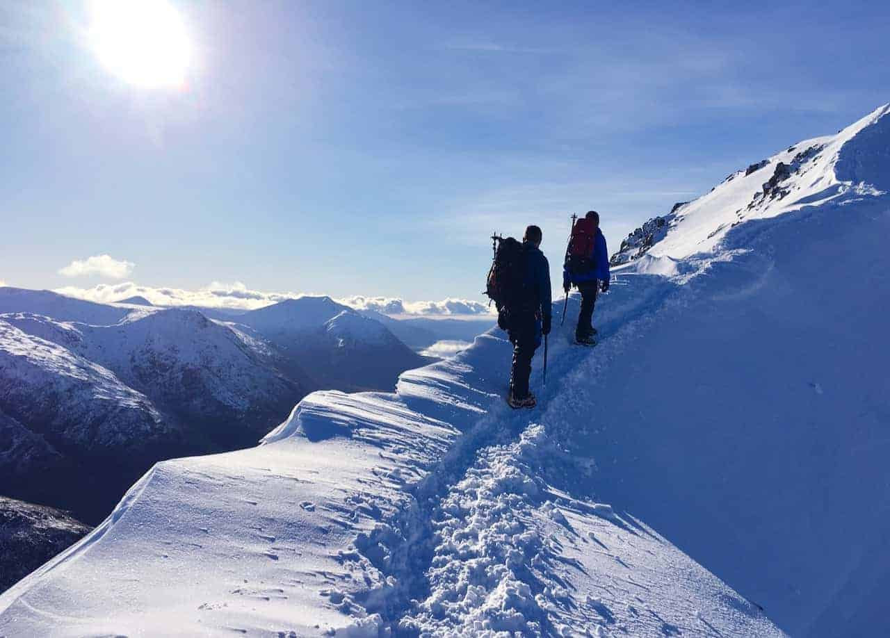 A winter skills course traverses a ridge in Scotland