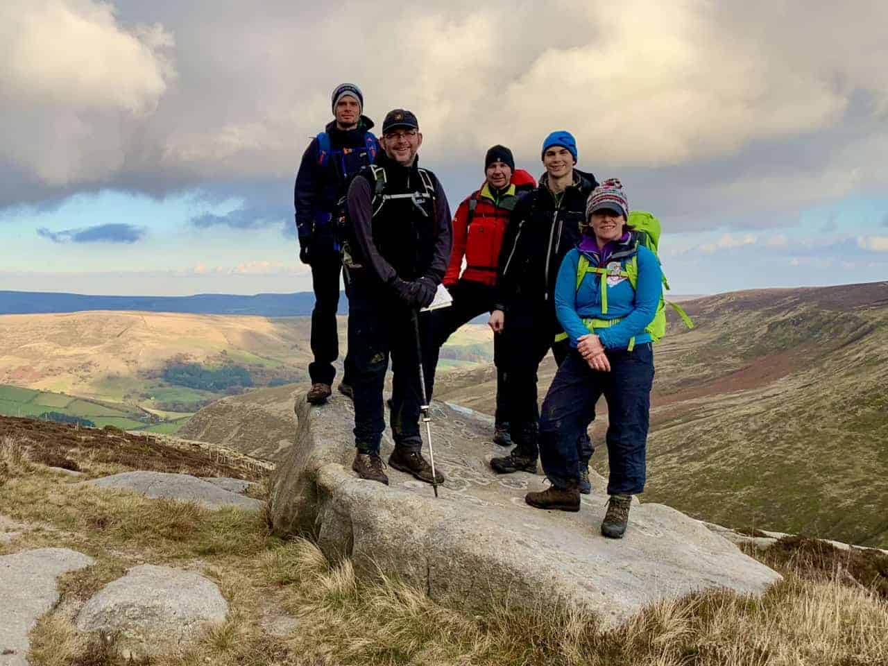 A walking group on the 9 Edges Challenge in the Peak District.