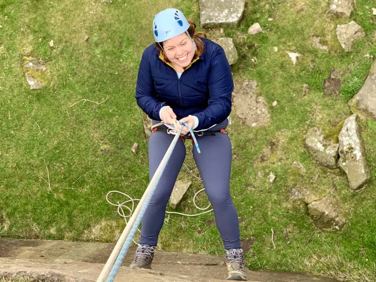 A lady abseiling on a challenge event