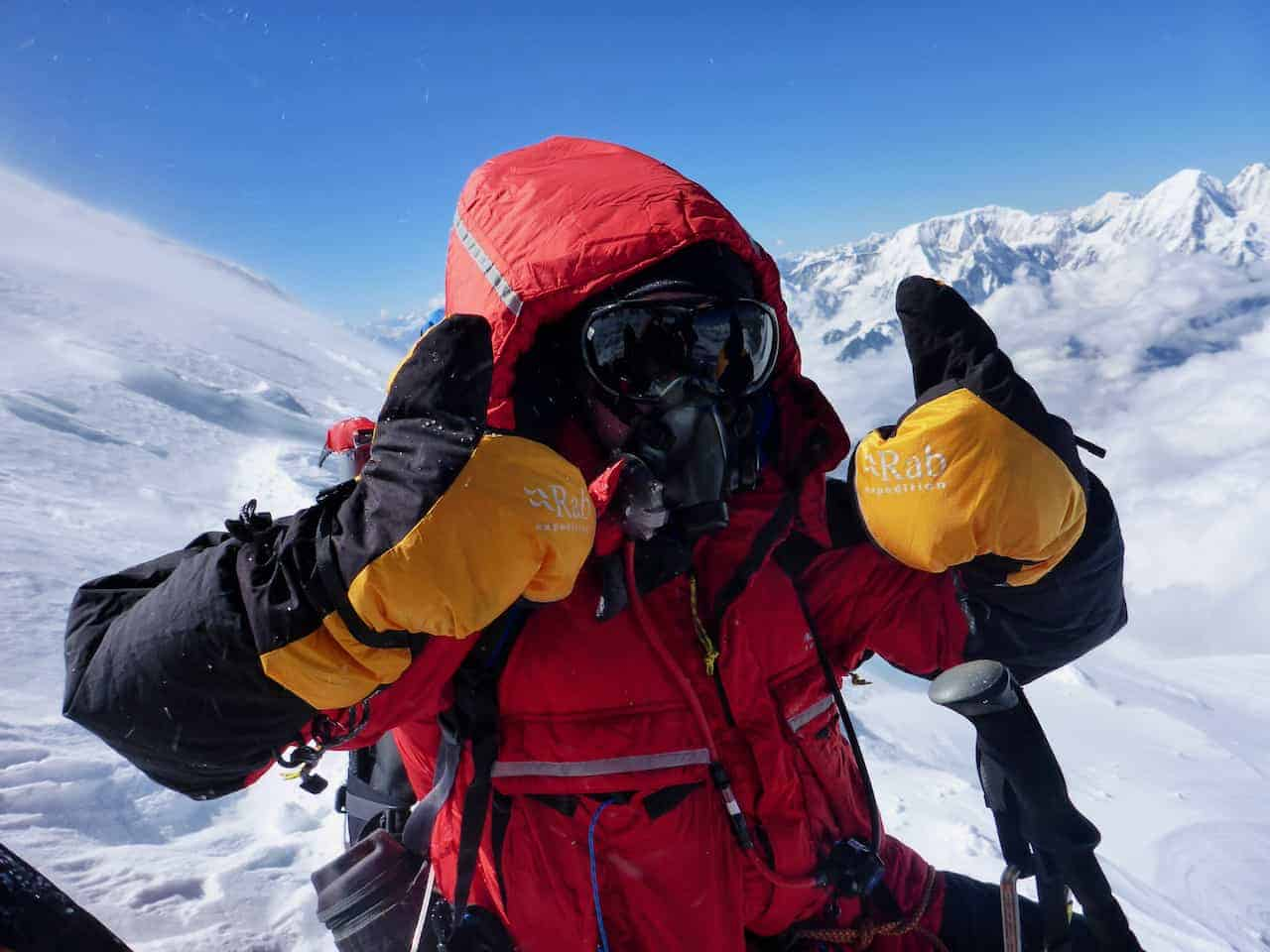 A man on a high altitude and remote expedition in Nepal climbing Manaslu